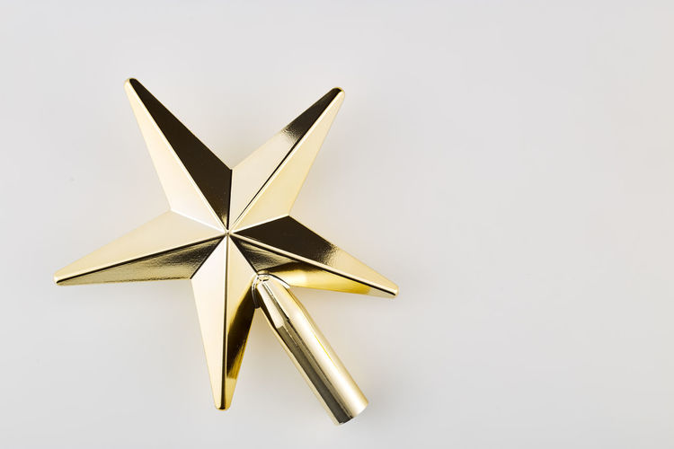 Star Shape Studio Shot Christmas White Background Christmas Decoration Shiny Celebration No People Decoration Indoors  Shape Holiday Single Object Copy Space Cut Out Event Gold Colored Celebration Event White Color Metal Christmas Ornament Silver Colored