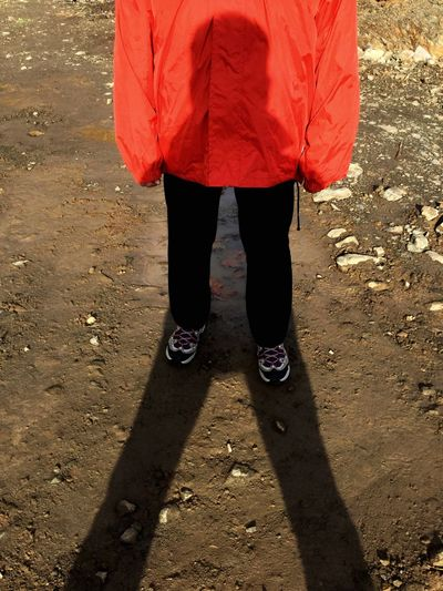 Illusion Of A Fixed Reality Low Section Outdoors Red Real People Leisure Activity Day One Person People Adult Shadows & Lights Shadowplay Rocky Landscape Red Jacket Black Trousers Sneekers Triangular Shapes My Year My View Visual Creativity