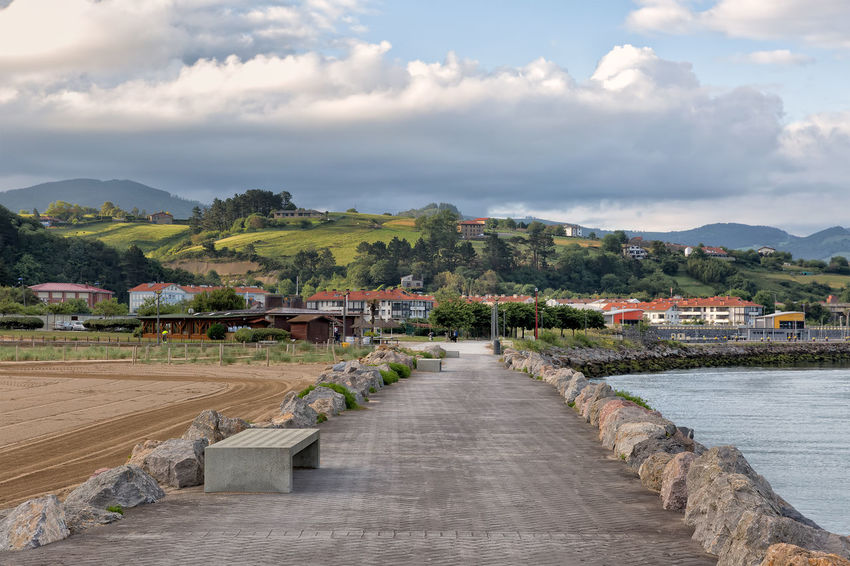 View from coast line in the hills direction Architecture Built Structure Cloud Cloud - Sky Cloudy Day Diminishing Perspective Hill Leading Mountain Nature No People Outdoors Residential District Scenics Sky The Way Forward Town TOWNSCAPE Tranquil Scene Tranquility Vanishing Point Walkway Water