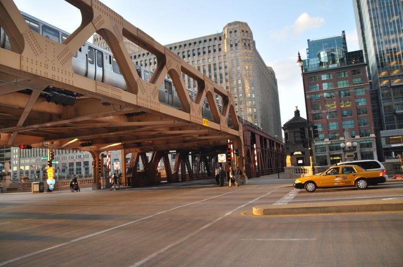 Train On Bridge Over Road In City