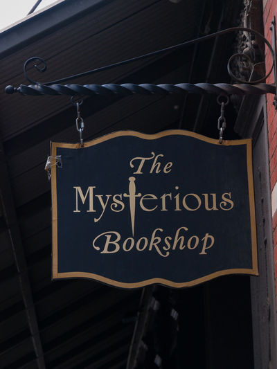 The Mysterious Book Shop ,New York USA Alibis Books Close-up Crime Day Hanging Mysterious Bookshop New York No People NYPD Outdoors Sky Text Trade Center Travel Destinations Vivid International