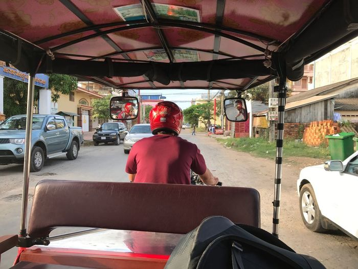 Transportation Land Vehicle Mode Of Transport Sitting Rear View Car One Person Driving Real People Road Day Travel Mature Adult Vehicle Seat Motorcycle Stationary Men Cambodia Explore Travel Lonetraveller Good Times TukTuk Outdoors Only Men Second Acts