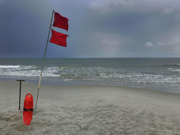 Beach closed - double red flag. Rescue Can Myrtle Beach Lifeguard  Ocean Storm Safety Unsafe Beach Closed Two Red Flags Red Flag Water Sea Beach Sky Land Horizon Flag Horizon Over Water Scenics - Nature Beauty In Nature Nature Red Cloud - Sky Day Tranquility Tranquil Scene Sand Wave Motion Outdoors