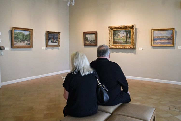 Rear View Men Museum Adult Real People Indoors  Togetherness Lifestyles Two People Women Picture Frame Architecture Frame Sitting Senior Women Wall - Building Feature Senior Adult Art Museum Males  People Paintings Flooring Couple - Relationship