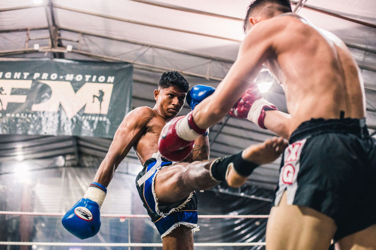 Alvin Vs. Ian (IV) Sport Athlete Strength Determination Exercising Healthy Lifestyle Vitality Men Competition Lifestyles Muscular Build Sports Training Adult Young Adult Young Men Competitive Sport Motion Two People Shirtless Effort Masculinity Kicking Fighting Muay Thai Fighters The Traveler - 2019 EyeEm Awards