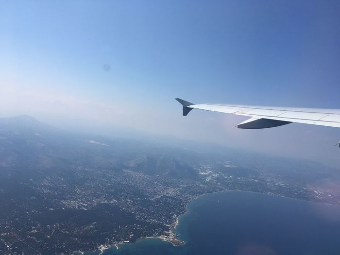 Aerial View Air Vehicle Aircraft Wing Airplane Airplane Wing Beauty In Nature Blue City Clear Sky Day Flying Journey Landscape Mid-air Mode Of Transport Mountain Nature No People Outdoors Scenics Sky Tranquility Transportation Travel View Into Land