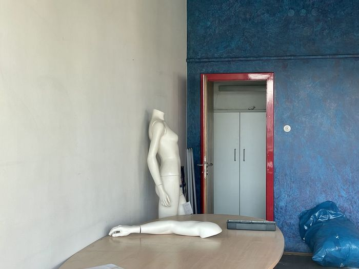 White door on table by building