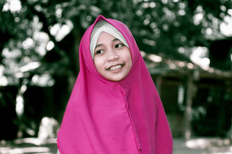 Smiling Girl Wearing Hijab Looking Away Outdoors