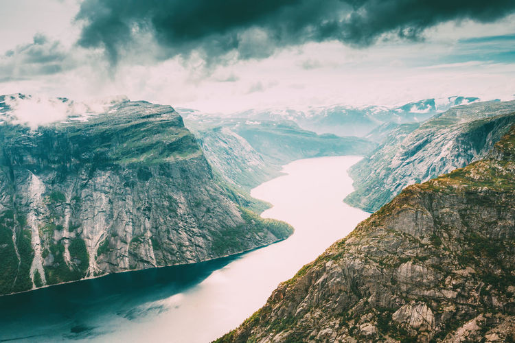 Scenic View From Rock Trolltunga - Troll Tongue In Norway Sky Water Day Snow Rock Winter Nature Clouds Trolltunga Troll Tongue Travel Norway Cloud - Sky Idyllic Valley Landscape Troll Beauty In Nature Mountain The Great Outdoors - 2019 EyeEm Awards
