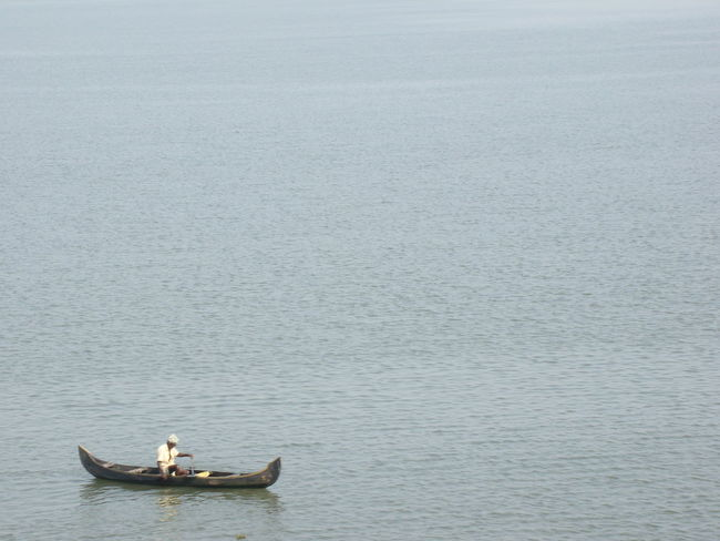 The lone fisherman Alone But Not Lonely Alone At Work Canoe Homebound Lonely Day Fishing Boat Nature Nautical Vessel Outdoors Water Rowing Fisherman Fishing Fishing Industry