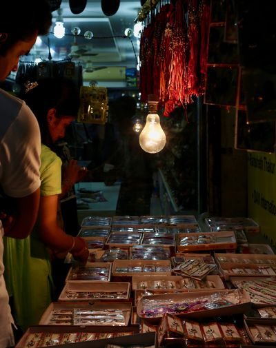 Rakhi stalls during rakshabandhan festival Nightphotography Adult Buyers Buyers And Sellers Human Hand Indianmarket Lifestyles Market Nighlife Night Rakshabandhan Real People Street Of India Streetphotography