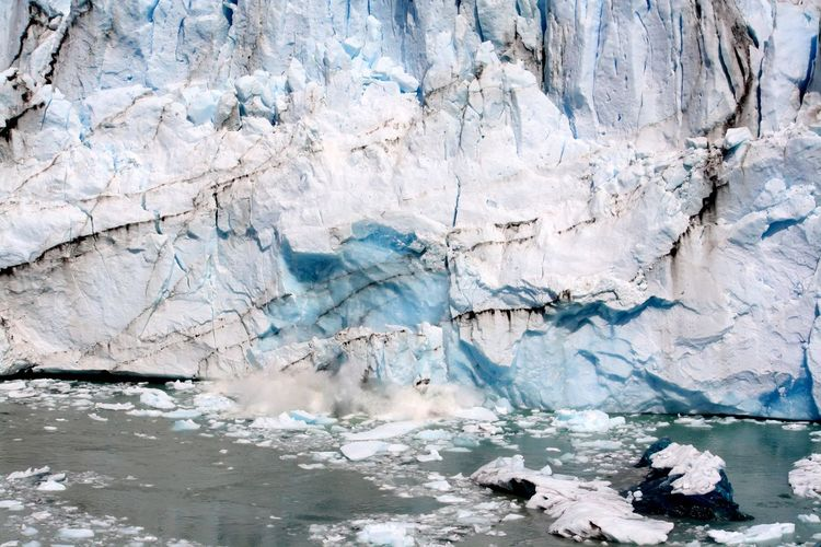Pieces of ice falling from glaciers because of warming