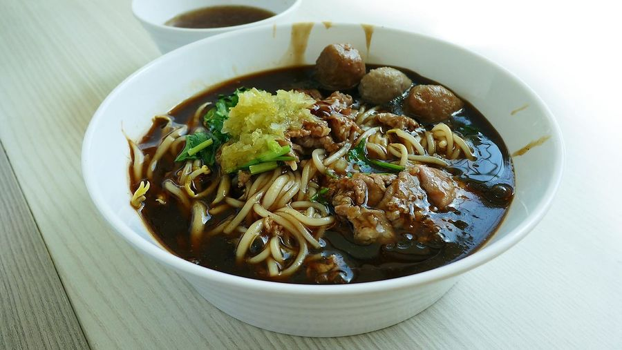 High Angle View Of Beef Noodles Served In Bowl On Table