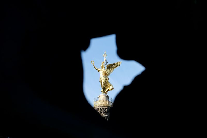 Low angle view of angel statue against black background