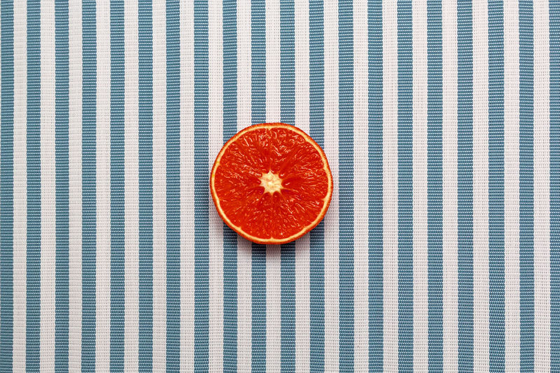 Top view of fresh red orange slice fruit on white blue striped background. Minimal style, food concept, flat lay. Fruit Food And Drink Healthy Eating Food Wellbeing Freshness Red Directly Above Studio Shot Orange Color No People Striped Shape Tablecloth Orange Vegetarian Food Cross Section Table Ripe Indoors  Still Life Pattern Close-up Orange - Fruit Minimal Style Food Concept Fresh On Eyeem