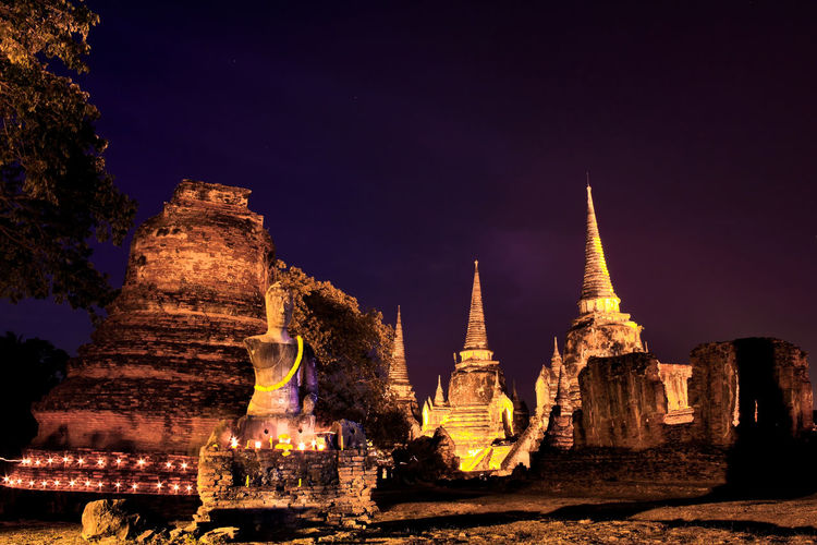 light candles and pray to buddha statue in temple Ancient Ancient Civilization Architecture Building Exterior Built Structure History Illuminated Nature Night No People Old Ruin Outdoors Place Of Worship Religion Sky Spirituality Travel Destinations