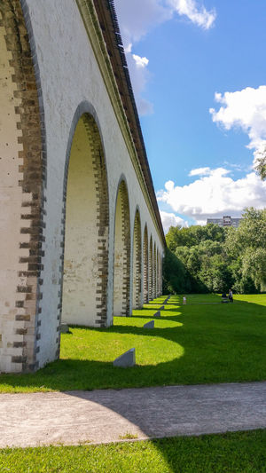 Architecture Grass Built Structure Arch Day No People Outdoors Building Exterior Sky Green Москва Russia Moscow мост Travel Destinations Architecture Cityscape Aqueduct Яуза City Bridge - Man Made Structure Low Angle View City Life Lawn Green Color
