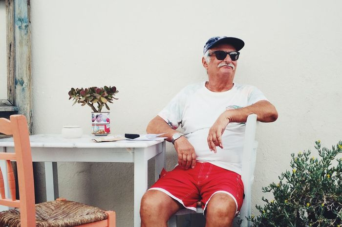 Relaxing Streetphotography Sunglasses Mature Men Mature Adult Casual Clothing Sitting Senior Men Front View Leisure Activity Real People Two People Men Day Technology Indoors  Adult People Howardography Havardstorvestre