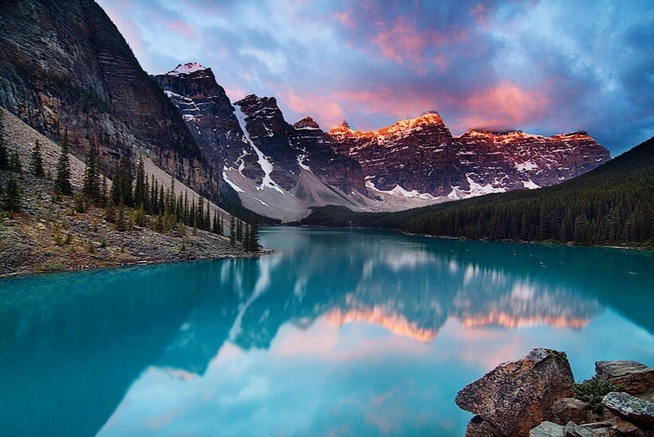 mountain, lake, scenics, snow, mountain peak, mountain range, wilderness, nature, reflection, water, cloud - sky, glacier, landscape, rock - object, beauty in nature, rocky mountains, pinaceae, travel destinations, ice, blue, no people, outdoors, cold temperature, winter, sky, sunset, purity, natural parkland, the natural world, day
