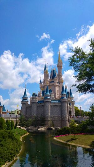 Disney Castle Disney Castle Water Sky Trees Clouds Green Blue Grass Outdoors No People Creation Creativity Building Orlando Vacation Vacation Time Day USA Sweden Godaminnen Florida Reflection Water Reflections