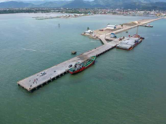 Cargo vessel docked at Palopo Harbour, South Sulawesi Sea Transportation South East Asia Palopo South Sulawesi INDONESIA Pier Dock Harbor Aerial Photography Cargo Global Trade Maritime Cargo Ship Cargo Vessel Nautical Vessel Water Sea High Angle View Transportation Ship Aerial View Mode Of Transport Nature Day Freight Transportation Shipping  Outdoors Moored Commercial Dock Scenics