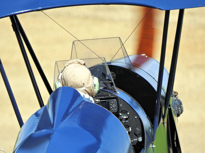 High angle view of man in biplane