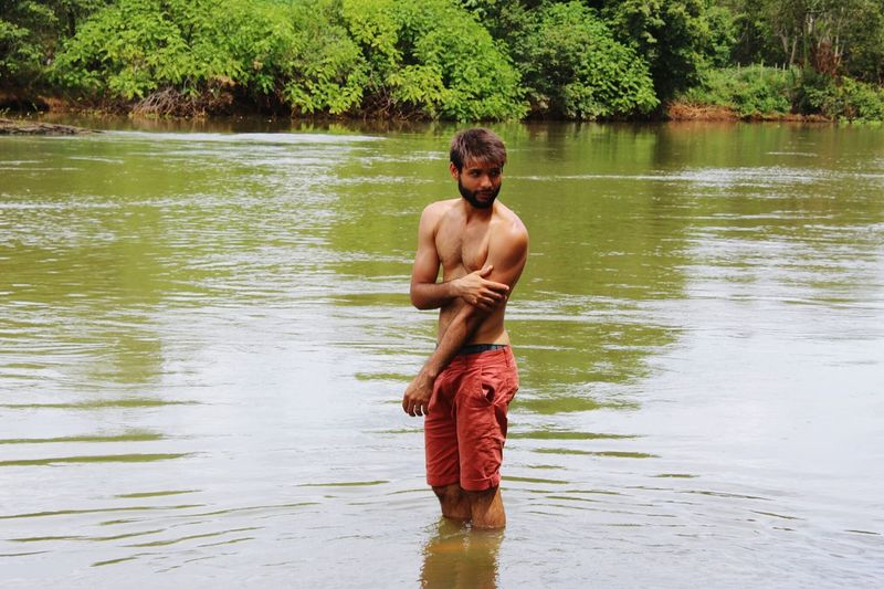 Rio Shirtless Water River One Man Only Adult Only Men One Person Rear View Standing Adults Only Men People Nature Lifestyles Outdoors Day Human Back Vacations Young Adult Ankle Deep In Water Plant