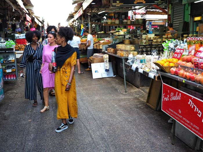 People standing by street market in city