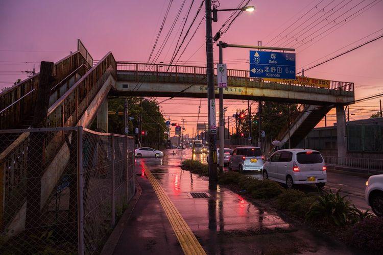 雨の日の夕焼け OSAKA Japan Japan Photography Sunset Rain Rainy Days Wet Wetroad Sky Architecture Bridge - Man Made Structure Vehicle Red Light Traffic Light  Stoplight
