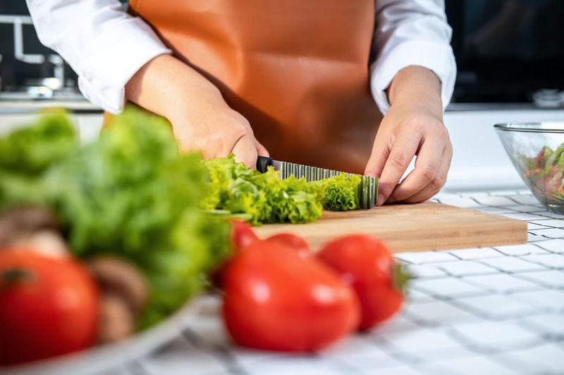Midsection of man preparing food