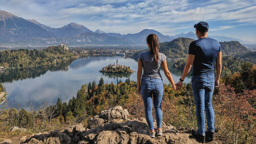 Two People Adults Only Adult Togetherness Men Standing People Women Full Length Casual Clothing Young Adult Young Women Leisure Activity Water Bonding Summer Bled Slovenia Hiking Backpack Mountain Outdoors Lake Day Lakeside Romance Jeans Hiker Girlfriend Boyfriend