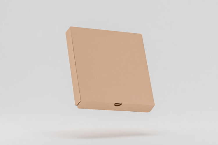 High angle view of mobile phone against white background