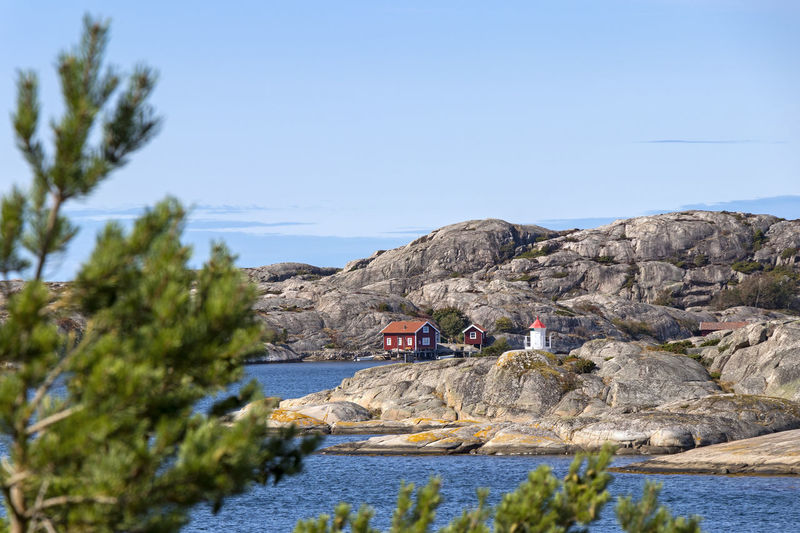 Old buildings or cabins, boats and a little lighthouse at the skerry coast (Sweden). Typical situation for the skerry coast. Sky Water Rock Clear Sky Plant Nature Architecture Day Rock - Object Tree Solid Building Exterior Built Structure Beauty In Nature Scenics - Nature No People Outdoors Sea Blue Norway Sweden Scandinavia Scandinavian Lighthouse North