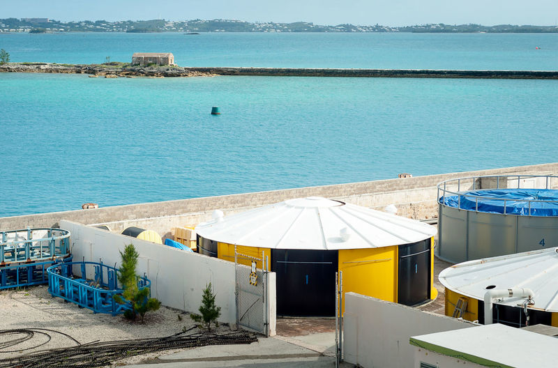 Gas deposits at Bermuda harbor. Architecture Atlantic Ocean Beach Bermudas Built Structure Container Day Gas Harbor High Angle View Horizon Over Water Island Nature No People Oil Outdoors Refinery Scenics Sea Sky Storage Water Waterfront