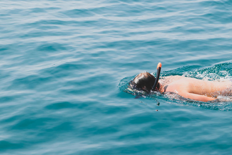 High angle view of man snorkeling in sea