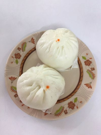 A Chinese steamed bun with bbq pork ,on plate and white background Oriental Filled Fluffy Eat Pork Red Tasty Yummy Carbohydrates Restaurant Meal China Town Steam BBQ Pork Bun Gourmet Si Food HongKong China Chinese Dimsum Food And Drink Food Freshness Plate Dumpling  Close-up Asian Food Frozen Food
