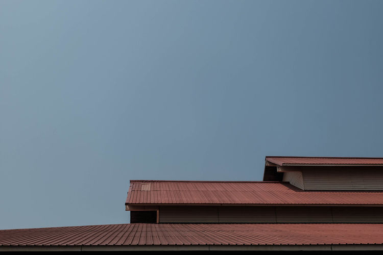 Architecture Built Structure Building Exterior Sky Building Low Angle View Roof Nature No People Clear Sky Copy Space Day House High Section Outdoors Blue Residential District Sunlight Chimney Dusk Roof Tile Corrugated