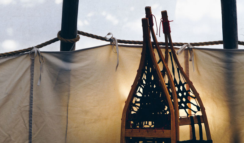 Snowshoes in teepee Aboriginal First Nations Snowshoe Close-up Coathanger Day Hanging Indoors  Inuit No People Old Sky Snowshoes Teepee Vintage