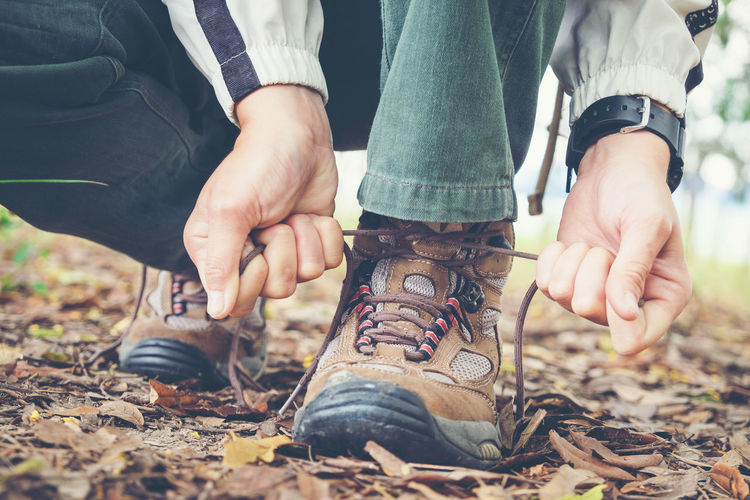 Boots Hiking Vacations Adventure Day Field Hand Human Foot Human Hand Human Leg Human Limb Jeans Land Leisure Activity Lifestyles Low Section Men Nature Outdoors People Real People Shoe Travle Two People