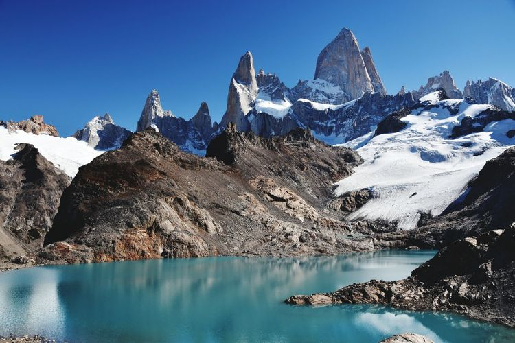 EyeEm Selects Mountain Snow Mountain Range No People Travel Destinations Snowcapped Mountain Mountain Peak Outdoors Scenics Sky Landscape Cold Temperature Day Nature Water Cerro Fitzroy Cerro Fitz Roy Argentina Beauty In Nature Lake Reflection Sunny Clear Sky Mountains