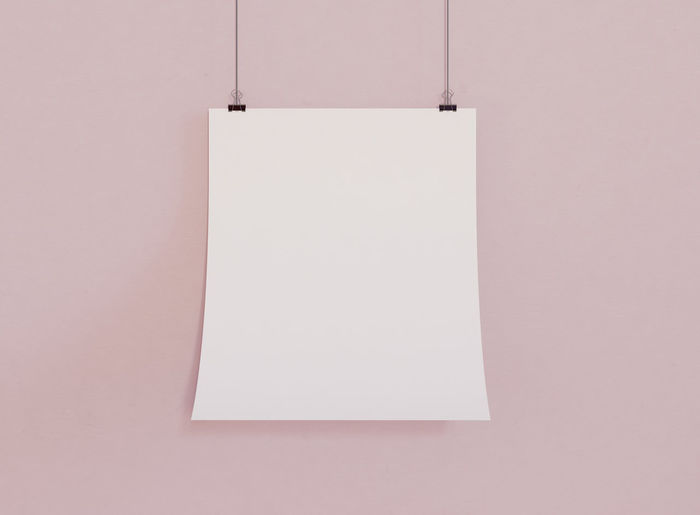 Close-up of empty paper against white wall