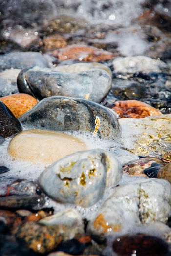 At Ground Level Backgrounds Flowing Pebbles Pebbles And Stones Pebbles And Water Rushing Water Sea Selective Focus Tidal Tide Water Water Surface