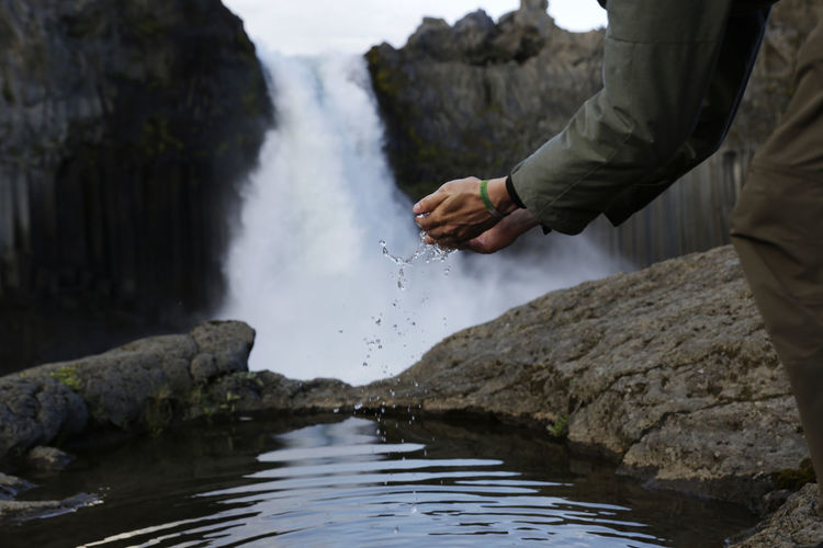 Adventure Aldeyjarfoss Beauty In Nature Blurred Motion Day Flowing Water Fun Human Body Part Human Hand Iceland Leisure Activity Lifestyles Men Motion Nature One Person Outdoors Real People Refreshment Rock - Object Splashing Spraying Water Waterfall Waterfront Done That.