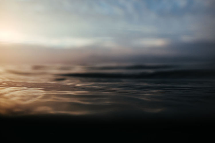Close-up of sea against sky during sunset