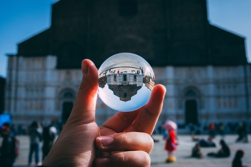 San Petronio - Bologna Church EyeEm Selects Human Hand Hand Holding Human Body Part One Person Building Exterior Real People Built Structure Personal Perspective Focus On Foreground Sphere Crystal Ball Finger Body Part Outdoors Reflection Architecture City Close-up