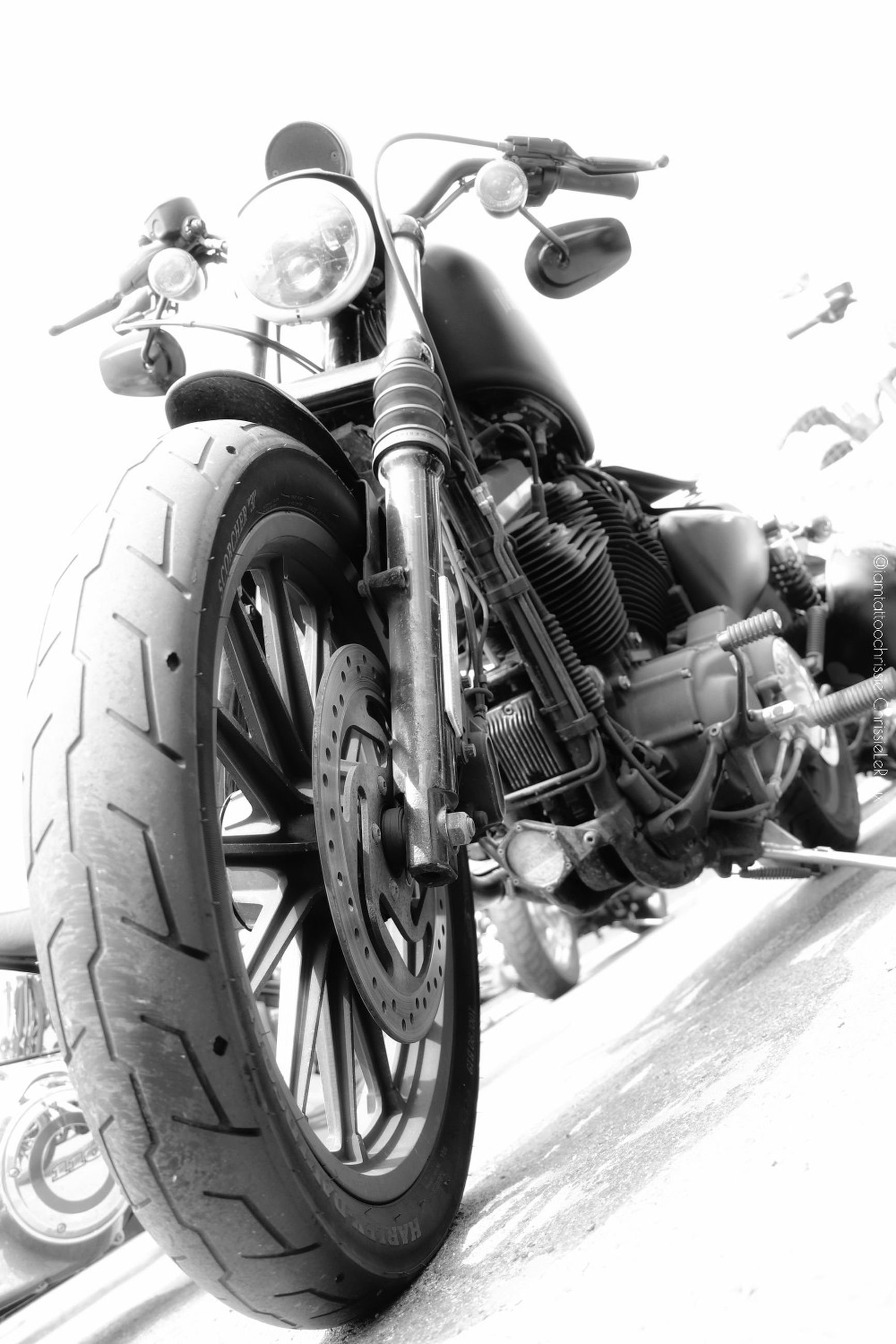 transportation, mode of transportation, motorcycle, land vehicle, day, street, one person, outdoors, nature, real people, city, low angle view, men, sky, stationary, road, wheel, helmet, scooter, crash helmet