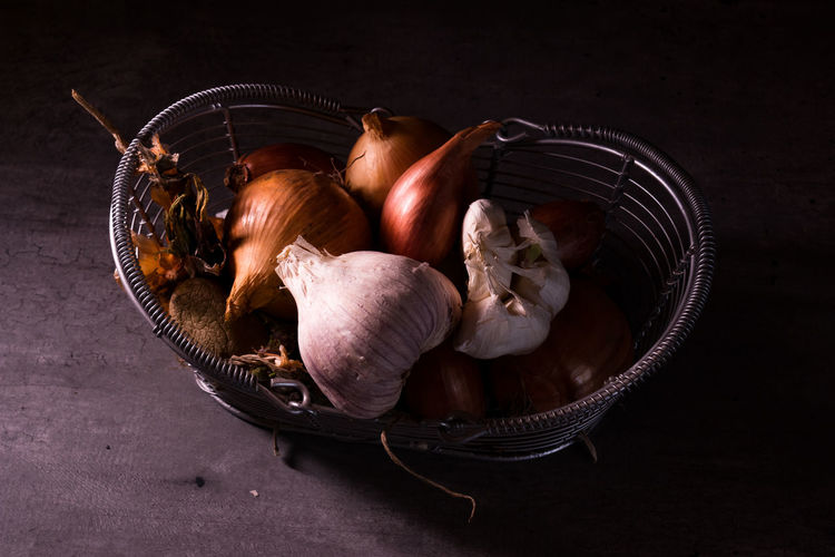 High angle view of mushrooms in basket on table
