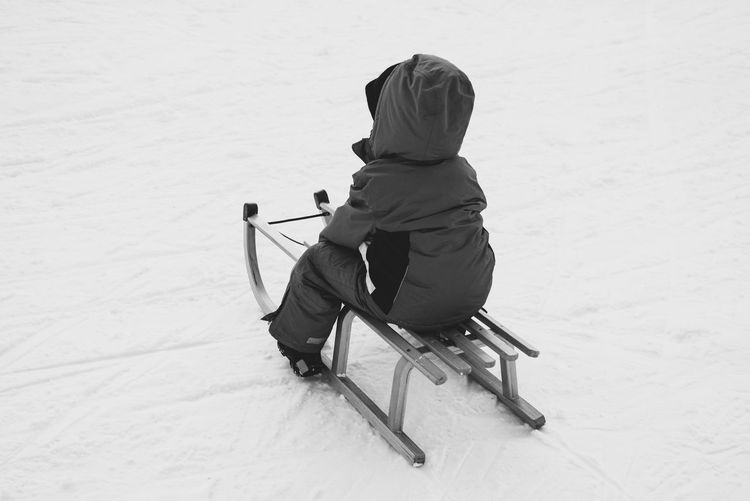 Adult Adventure Blackandwhite Cold Temperature Day Full Length Occupation One Person Outdoors People Real People Skiing Sled Snow Vacations Winter