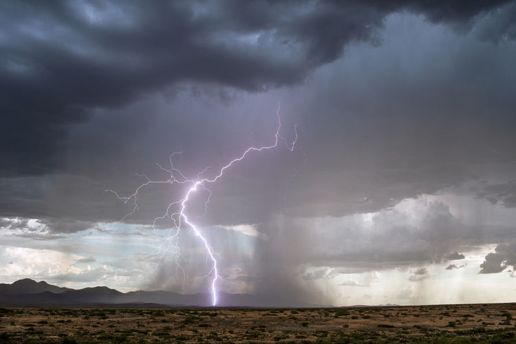 Lightning strikes from a monsoon storm over the chiricahua mountains near willcox, arizona.