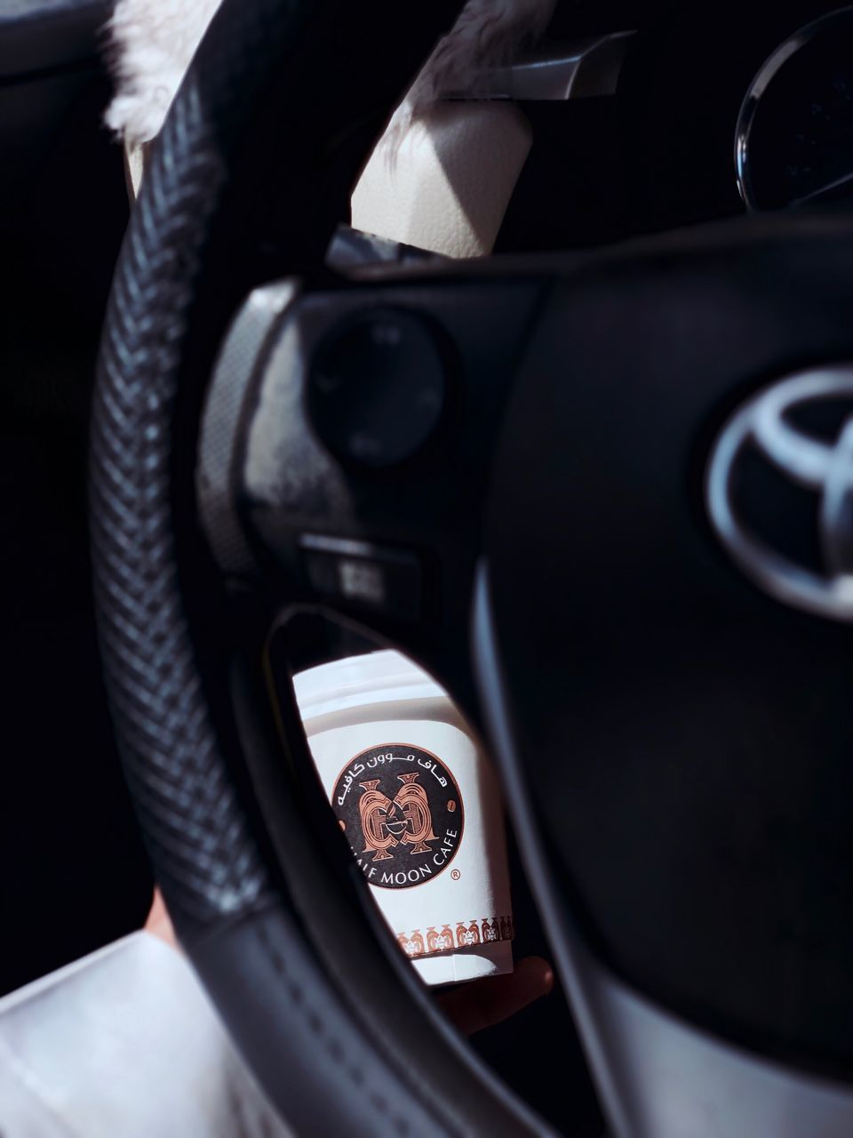 close-up, no people, indoors, vehicle interior, number, technology, equipment, gearshift, car interior, still life, transportation, black color, mode of transportation, communication, photography themes, focus on foreground, control, selective focus, text, shape
